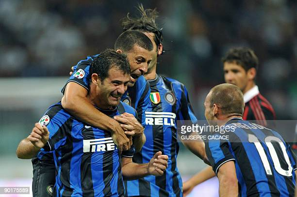Inter Milan's Serbian midfielder Dejan Stankovic celebrates with Inter Milan's Brazilian defender Lucio Da Silva Ferreira Lucimar and Inter Milan's...