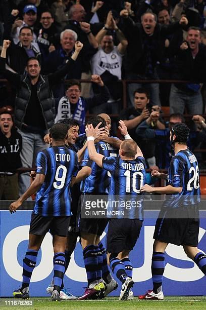 Inter Milan's Serbian midfielder Dejan Stankovic celebrates with team mates after scoring against Schalke during their UEFA Champions League quarter...