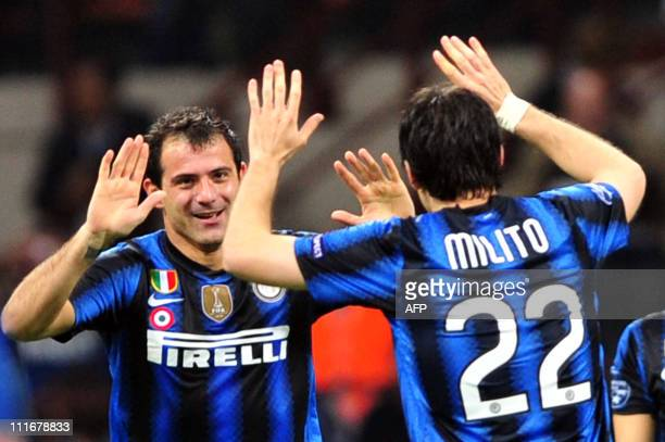 Inter Milan's Serbian midfielder Dejan Stankovic celebrates with team mate Argentine forward Milito after scoring against Schalke during their UEFA...