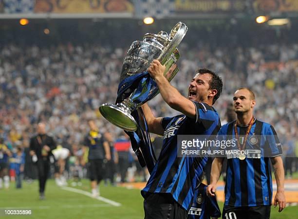 Inter Milan's Serbian midfielder Dejan Stankovic celebrates with the trophy after winning the UEFA Champions League final football match Inter Milan...
