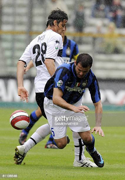 Inter Milan's Serbian midfielder Dejan Stankovic fights for the ball with Parma's defender Massimo Paci, during the Italian Serie A football match...