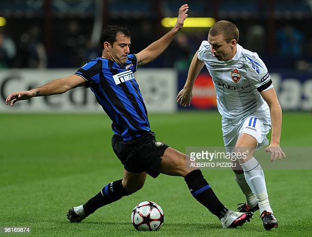 Inter Milan's Serbian midfielder Dejan Stankovic fights for the ball with Cska Moscow's midfielder Pavel Mamaev during their Champions League first...