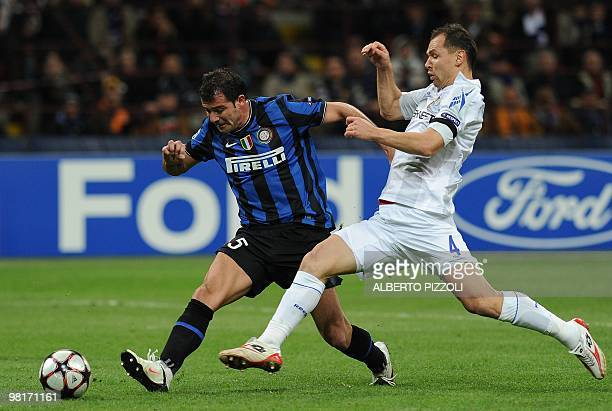 Inter Milan's Serbian midfielder Dejan Stankovic fights for the ball with Cska Moscow's defender Sergei Ignashevich during their Champions League...