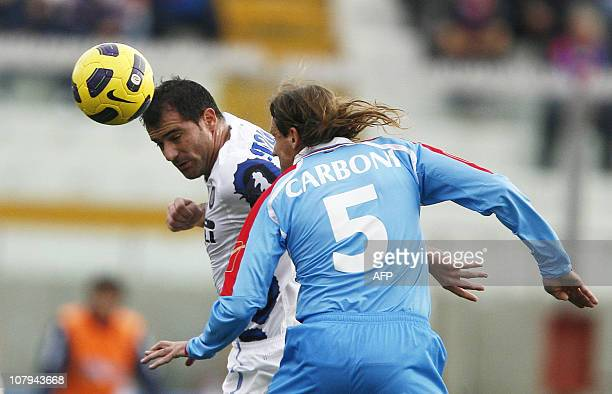 Inter Milan's serbian midfielder Dejan Stankovic heads the ball with Catania's Argentine defender Ezequiel Carboni during their Italian Serie A...