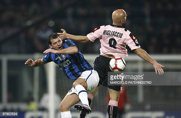 Inter Milan's Serbian midfielder Dejan Stankovic heads the ball with Palermo's defender Giulio Migliaccio during their Serie A football match at...
