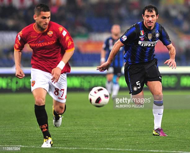 Inter Milan's Serbian midfielder Dejan Stankovic runs for the ball with AS Roma's midfielder Aleandro Rosi during Italian Tim Cup first leg...