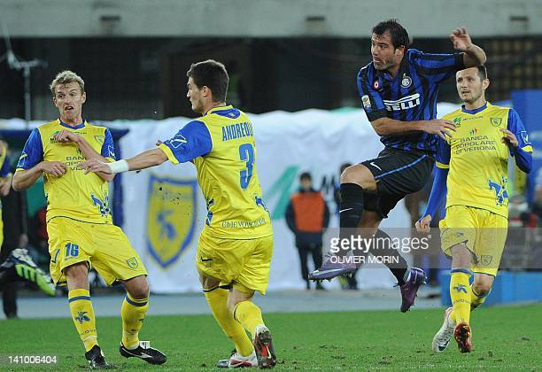 Inter Milan's Serbian midfielder Dejan Stankovic shots past Chievo during the Italian serie A football match Chievo Verona against Inter Milan on...
