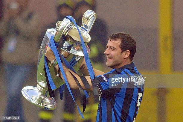 Inter Milan's Serbian midfielder Dejan Stankovic shows the Champions League Trophy to their supporters at San Siro stadium in Milan after their...
