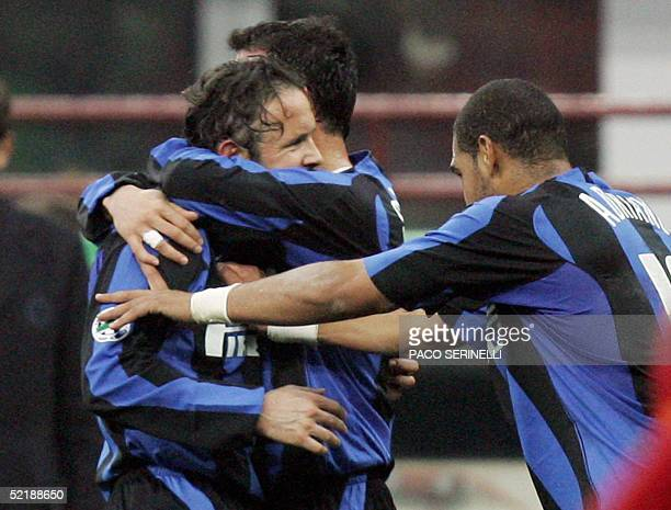 Inter Milan's Sinisa Mihajlovic celebrates with teammates Adriano and Dejan Stankovic after scores against AS Roma during their italian serie A...