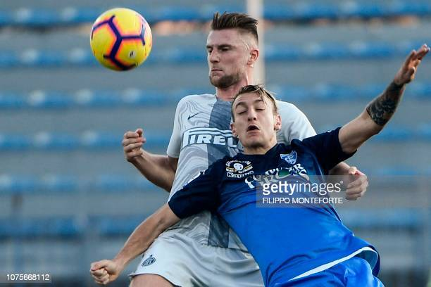 Inter Milan's Slovak defender Milan Skriniar and Empoli's Italian forward Antonino La Gumina go for the ball during the Italian Serie A football...