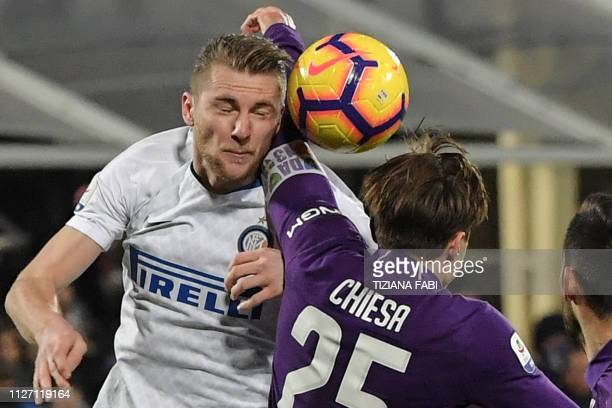 Inter Milan's Slovak defender Milan Skriniar and Fiorentina's Italian forward Federico Chiesa go for a header during the Italian Serie A football...