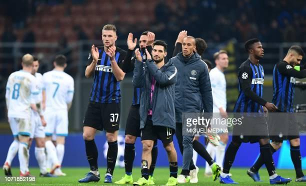 Inter Milan's Slovak defender Milan Skriniar and Inter Milan's Italian midfielder Matteo Politano acknowledge the public at the end of the UEFA...