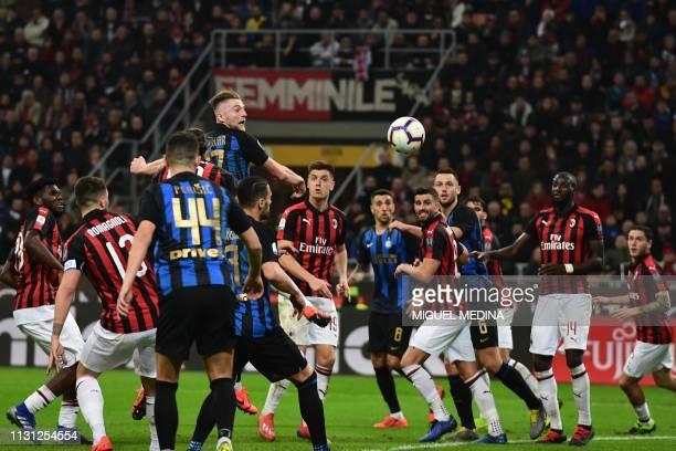 Inter Milan's Slovak defender Milan Skriniar heads the ball during the Italian Serie A football match AC Milan vs Inter Milan at the San Siro stadium...