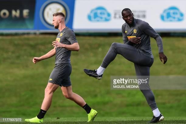Inter Milan's Slovakian defender Milan Skriniar and Inter Milan's Belgian forward Romelu Lukaku exercise during a training session on October 22,...