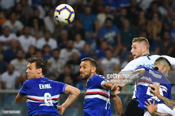 Inter Milan's Slovakian defender Milan Skriniar heads the ball in front of Sampdoria's defence during the Italian Serie A football match between...