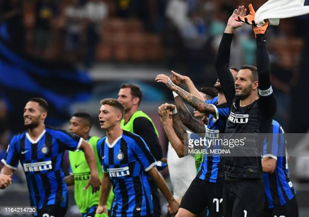 Inter Milan's Slovenian goalkeeper Samir Handanovic and teammates acknowledge the public at the end of the Italian Serie A football match Inter Milan...