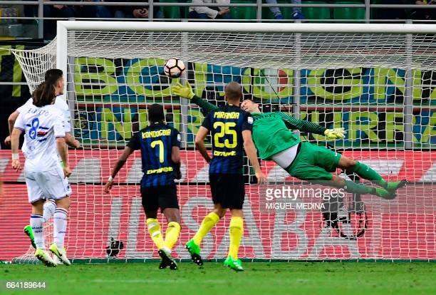 Inter Milan's Slovenian goalkeeper Samir Handanovic dives and fails to stop the ball during the Italian Serie A football match between Inter Milan...