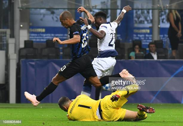 Inter Milan's Slovenian goalkeeper Samir Handanovic dives as Inter Milan's Brazilian defender Miranda and Tottenham's Ivorian defender Serge Aurier...