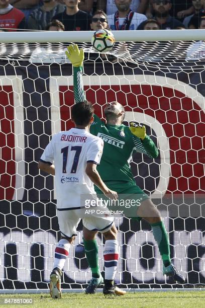 Inter Milan's Slovenian goalkeeper Samir Handanovic makes a save in front of Crotone's Croatian forward Ante Budimir during the Italian Serie A...