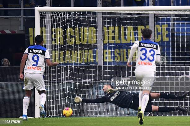 Inter Milan's Slovenian goalkeeper Samir Handanovic saves a penalty kicked by Atalanta's Columbian forward Luis Muriel during the Italian Serie A...