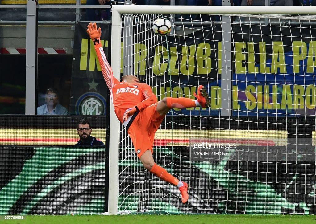 Inter Milan's Slovenian goalkeeper Samir Handanovic stretches and fails to stop a shot by Sassuolo's Italian forward Domenico Berardi (unseen) during the Italian Serie A football match Inter Milan vs Sassuolo at the San Siro stadium in Milan on Mai 12, 2018.