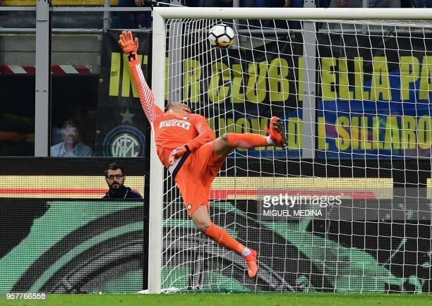 Inter Milan's Slovenian goalkeeper Samir Handanovic stretches and fails to stop a shot by Sassuolo's Italian forward Domenico Berardi during the...