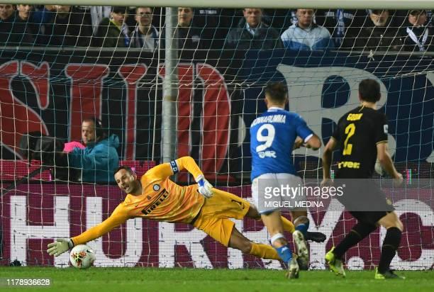 Inter Milan's Slovenian goalkeeper Samir Handanovic stretches to stop the ball kicked by Brescia's Italian forward Alfredo Donnarumma during the...