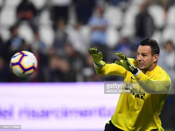 Inter Milan's Slovenian goalkeeper Samir Handanovic warms up prior to the Italian Serie A football match Spal vs Inter Milan in Ferrara on October 7...