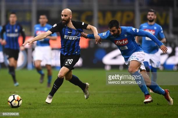 Inter Milan's Spanish midfielder Borja Valero outruns Napoli's Spanish defender Raul Albiol during the Italian Serie A football match Inter Milan vs...