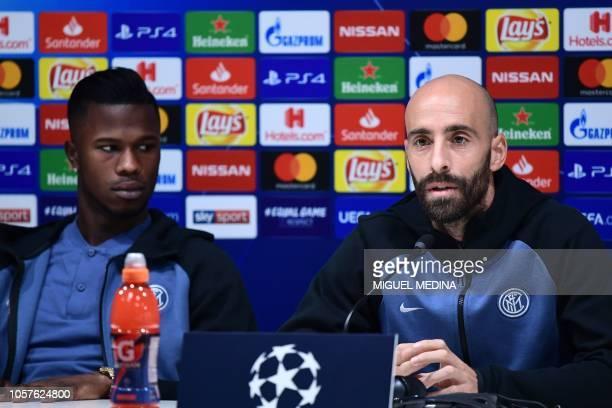 Inter Milan's Spanish midfielder Borja Valero speaks as Inter Milan's Senegalese forward Keita Balde looks on during a press conference on November 5...
