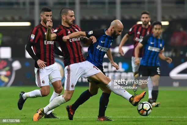 Inter Milan's Spanish midfielder Iglesias Borja Valero vies with AC Milan's Captain Italian defender Leonardo Bonucci during the Italian Serie A...