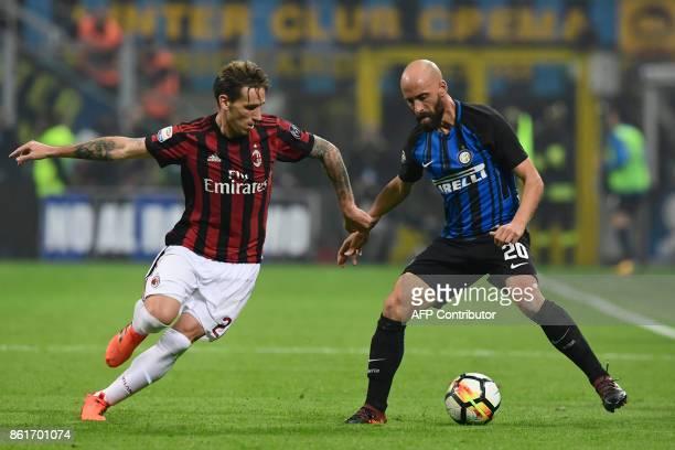 Inter Milan's Spanish midfielder Iglesias Borja Valero vies with AC Milan's Argentinian midfielder Lucas Biglia during the Italian Serie A football...