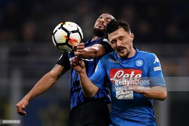 TOPSHOT Inter Milan's SpanishBrazilian forward Rafinha and Napoli's Portuguese defender Mario Rui go for a header during the Italian Serie A football...