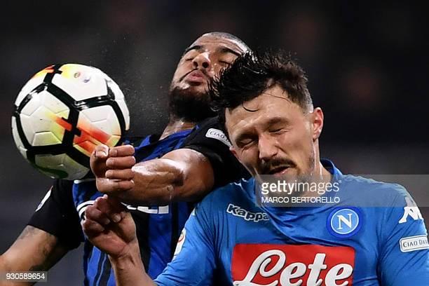 Inter Milan's SpanishBrazilian forward Rafinha and Napoli's Portuguese defender Mario Rui go for a header during the Italian Serie A football match...