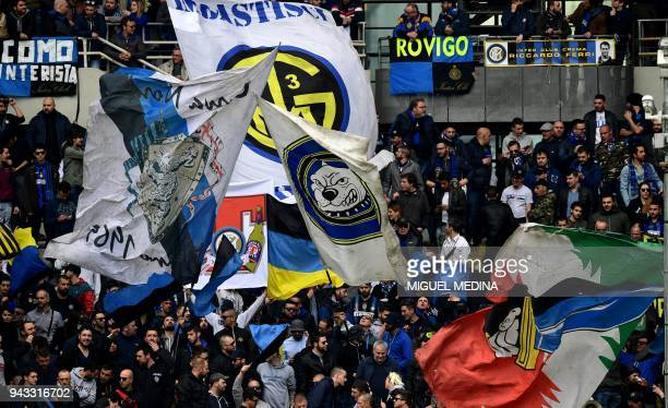 Inter Milan's supporters cheer during the Italian Serie A football match Torino FC vs Inter Milan at the Olympic stadium in Turin on April 8 2018 /...