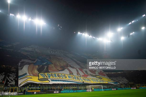 Inter Milan's supporters hold banner during the Italian Serie A football match Inter Milan vs AC Milan on February 9 2020 at the San Siro stadium in...