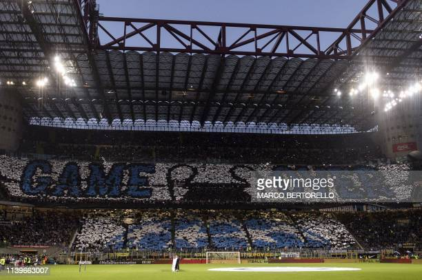 TOPSHOT Inter Milan's supporters hold placards reading Game over dedicated to the elimination of Juventus from the Champions League during the...