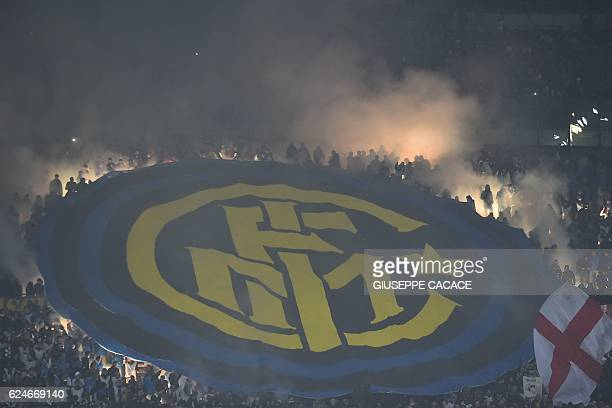 TOPSHOT Inter Milan's supporters light flares during the Italian Serie A football match AC Milan Vs Inter Milan on November 20 2016 at the 'San Siro...