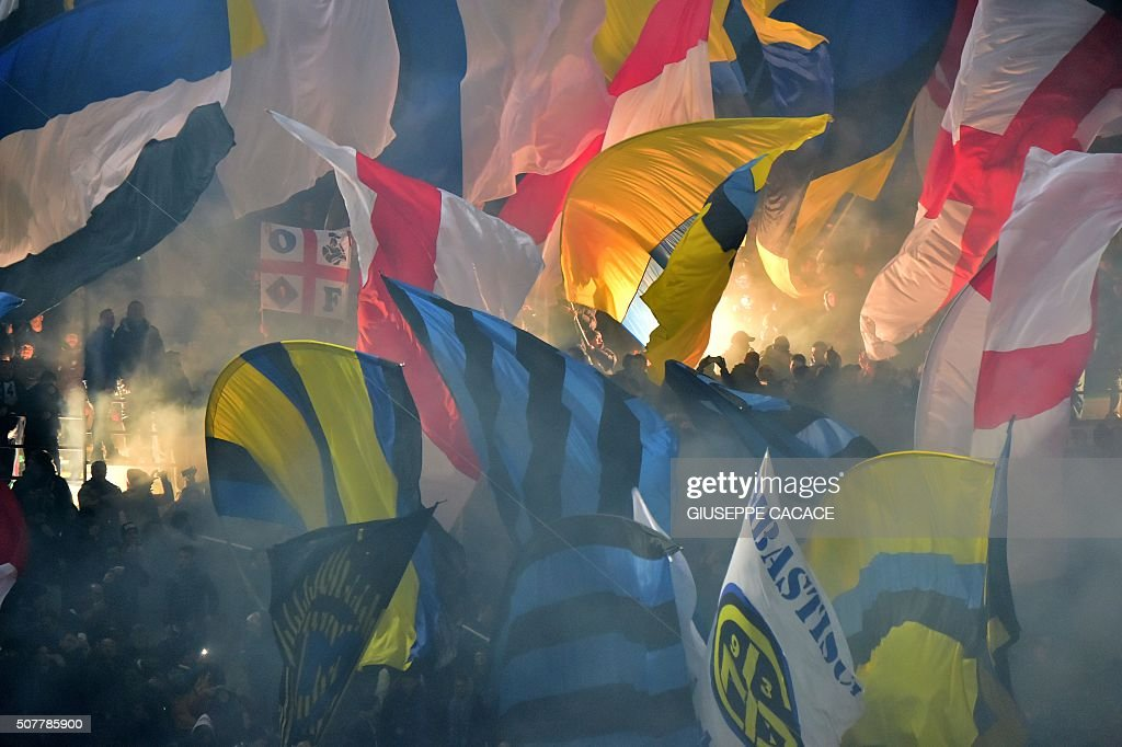 TOPSHOT - Inter Milan's supporters wave flags during the Italian Serie A football match between AC Milan and Inter Milan at San Siro Stadium in Milan on January 31, 2016. / AFP / GIUSEPPE
