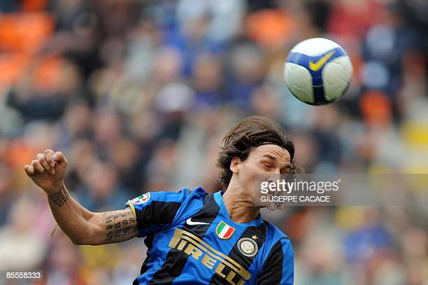 Inter Milan's Swedish forward Zlatan Ibrahimovic heads the ball against Reggina during their Italian Serie A football match Ion March 22 2009 at San...