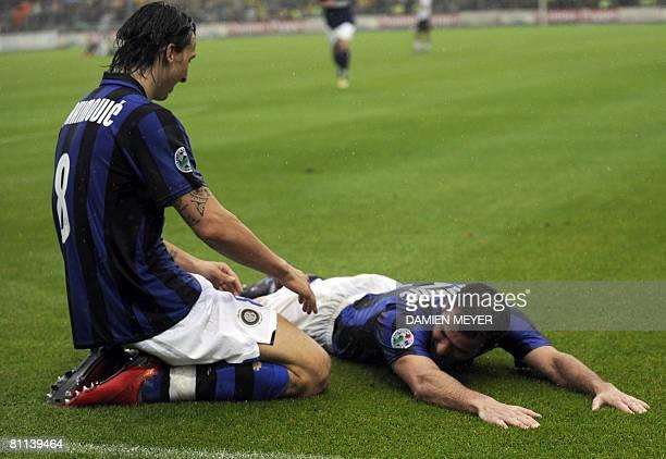 Inter Milan's Swedish forward Zlatan Ibrahimovic jubilates with Inter Milan's Serbian midfielder Dejan Stankovic after he scored a second goal during...