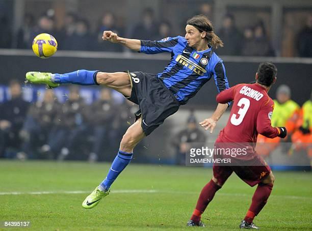 Inter Milan's Swedish forward Zlatan Ibrahimovic kicks the ball despite AS Roma's Brazilian defender Cicinho during their Italian Cup football match...