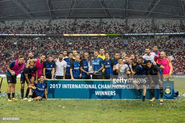 Inter Milan's team poses for photographers after defeating Chelsea FC in their International Champions Cup football match in Singapore on July 29 2017
