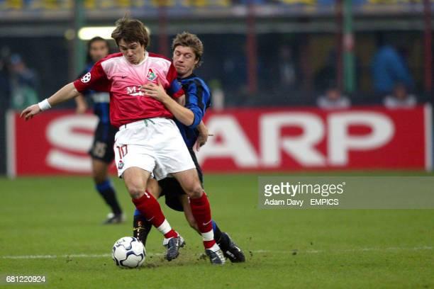 Inter Milan's Thomas Helveg and Lokomotiv Moscow's Dmitri Loskov battle for the ball
