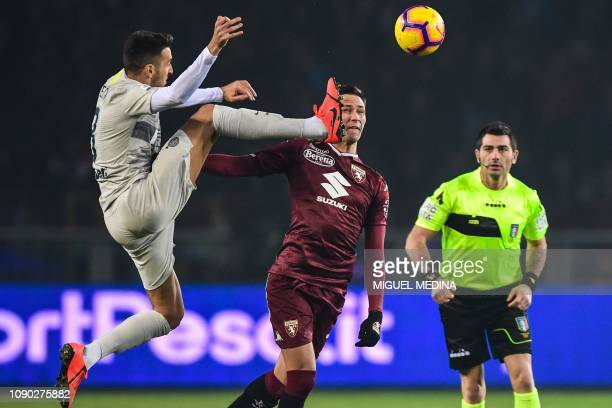 Inter Milan's Uruguayan midfielder Matias Vecino and Torino's Serbian midfielder Sasa Lukic go for the ball as Italian referee Fabio Maresca looks on...
