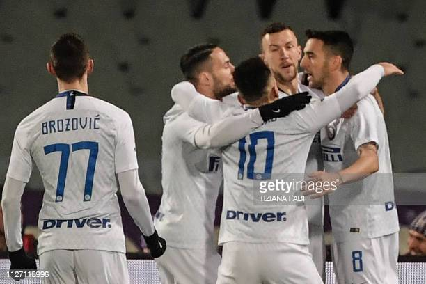 Inter Milan's Uruguayan midfielder Matias Vecino celebrates with teammates after scoring an equalizer during the Italian Serie A football match...