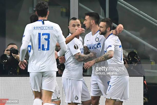 Inter Milan's Uruguayan midfielder Matias Vecino celebrates with teammates after opening the scoring during the UEFA Europa League round of 32...
