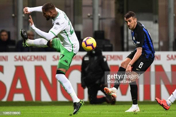 Inter Milan's Uruguayan midfielder Matias Vecino centres the ball despite Sassuolo's Ghanaian forward Kevin-Prince Boateng during the Italian Serie A...
