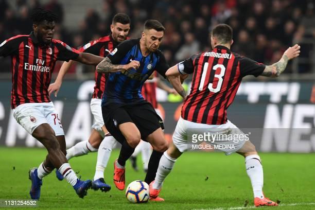 Inter Milan's Uruguayan midfielder Matias Vecino challenges AC Milan's Ivorian midfielder Franck Kessie and AC Milan's Italian defender Alessio...