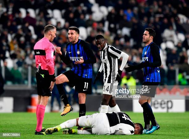 Inter Milan's Uruguayan midfielder Matias Vecino reacts as he speaks with referee Paolo Valeri after stepping on the ankle of Juventus' Morocco...